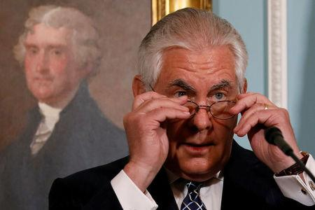 U.S. Secretary of State Rex Tillerson adjusts his glasses as he delivers remarks on the 2016 International Religious Freedom Annual report at the State Department in Washington, U.S. August 15, 2017.  REUTERS/Jonathan Ernst