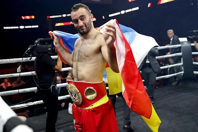 Murat Gassiev, seen here after defeating Krzysztof Wlodarczyk in October, improved his record to 27-0 on Saturday with a technical knockout of Yunier Dorticos, adding the WBA cruiserweight title to his IBF belt (AFP Photo/Abbie Parr)