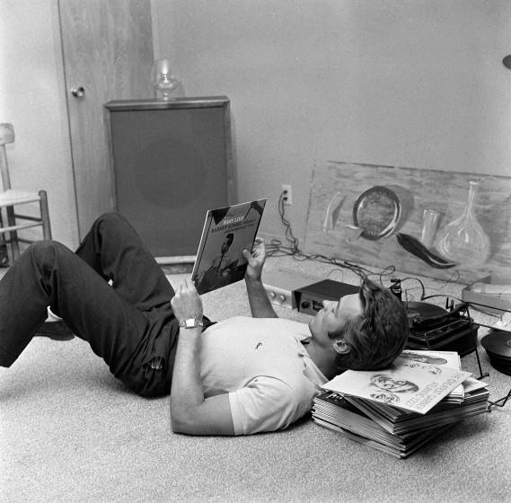 """Clint Eastwood listens to records at his home in 1959. <span class=""""copyright"""">(CBS Photo Archive/Getty Images)</span>"""