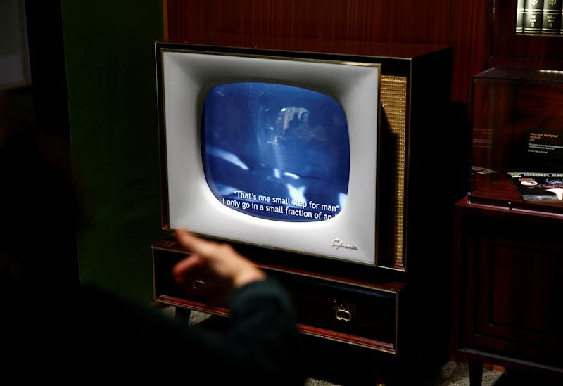 "A visitor watches footage from the moon landing in a recreated 1960s-style living room on the anniversary of the Apollo 11 mission launch at the ""Destination Moon: The Apollo 11 Mission"" exhibit at the Museum of Flight in Seattle, Washington, U.S., July 16, 2019. REUTERS/Lindsey Wasson"