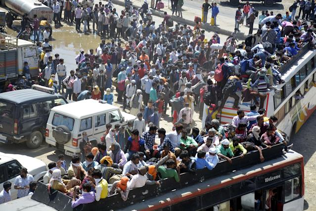 GHAZIABAD, INDIA - MARCH 28: An aerial view of Lal Kuan bus stand where a wave of migrant workers was seen following Uttar Pradesh governments call to arrange buses for the workers returning to their native state, on Day 4 of the 21 day nationwide lockdown -- to check the spread of coronavirus, on March 28, 2020 in Ghaziabad, India. (Photo by Sakib Ali/Hindustan Times via Getty Images)