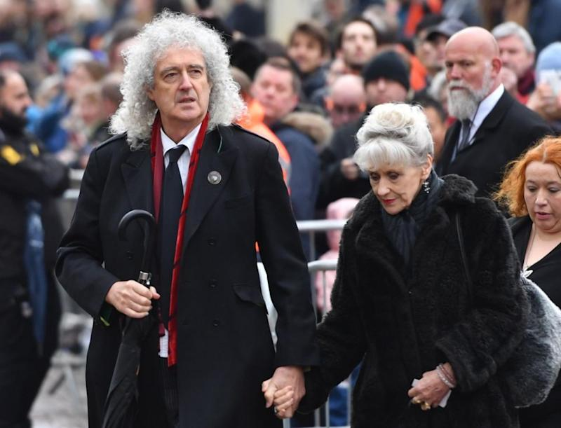 Queen guitarist Brian May arrived at the service with his wife. Photo: AAP