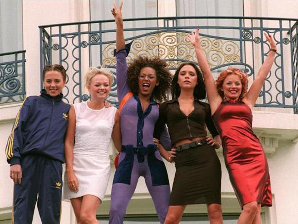 The Spice Girls pose for photographers in front of the Martinez Hotel in Cannes in 1997 (AFP/Getty)
