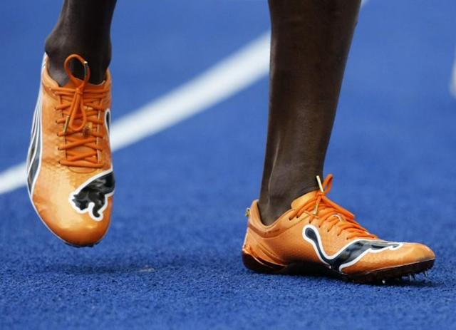 Usain Bolt of Jamaica sports new running shoes after the ninth men's 100 metres heats during the world athletics championships at the Olympic stadium in Berlin, August 15, 2009. REUTERS/Michael Dalder/Files