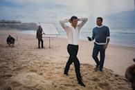 <p>George Lazenby films a scene for 'On Her Majesty's Secret Service' on location on the Praia do Guincho (Guincho Beach), near Cascais in Portugal, 1969. Here he is captured by henchman Raphael, played by stuntman Terry Mountain. </p>