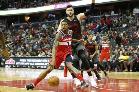 Nov 18, 2018; Washington, DC, USA; Washington Wizards guard Bradley Beal (3) dribbles the ball as Portland Trail Blazers center Jusuf Nurkic (27) defends during the second quarter at Capital One Arena. Mandatory Credit: Amber Searls-USA TODAY Sports