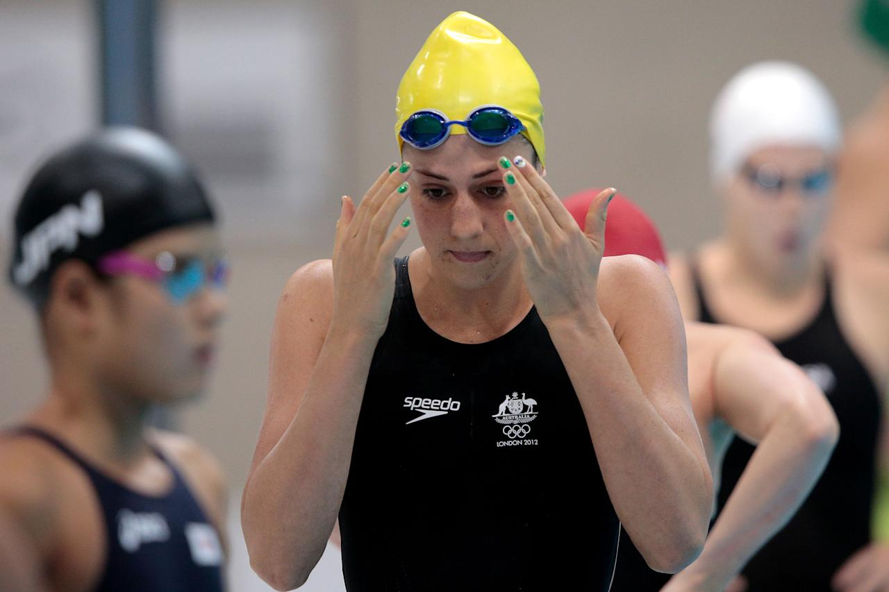 LONDON, ENGLAND - JULY 28:  Stephanie Rice of Australia looks on as she prepares to compete in heat four of the Women's 400m Individual Medley on Day One of the London 2012 Olympic Games at the Aquatics Centre on July 28, 2012 in London, England.  (Photo by Adam Pretty/Getty Images)
