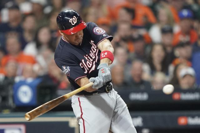 FILE - In this Oct. 22, 2019, file photo, Washington Nationals' Ryan Zimmerman hits a home run during the second inning of Game 1 of the baseball World Series against the Houston Astros in Houston. A person familiar with the negotiations tells the AP that face of the franchise Zimmerman and the Nationals have agreed to terms on a $2 million deal for 2020. The deal is pending a physical. (AP Photo/David J. Phillip, File)