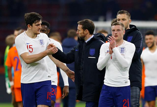 Soccer Football - International Friendly - Netherlands vs England - Johan Cruijff Arena, Amsterdam, Netherlands - March 23, 2018 England's Harry Maguire with England manager Gareth Southgate and England's Jamie Vardy REUTERS/Michael Kooren