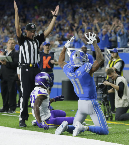 Detroit Lions wide receiver Marvin Jones (11), raises his arms after an catching an 11-yard pass for a touchdown during the first half of an NFL football game against the Minnesota Vikings, Sunday, Oct. 20, 2019, in Detroit. (AP Photo/Duane Burleson)
