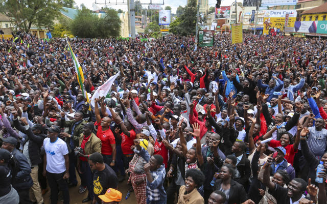 Thousands of Kenyans come out into the streets to celebrate Eliud Kipchoge's sub-2 hour marathon time, in the Rift Valley town of Eldoret where he lives and trains, in Kenya Saturday, Oct. 12, 2019. Eliud Kipchoge sent shockwaves through the world of sport by becoming the first athlete to break the two-hour barrier for a marathon, at an event set up for the attempt in Austria, although it will not count as a world record. (AP Photo)