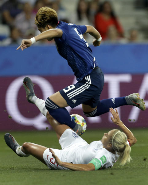 Japan's Yuika Sugasawa, top, and England's Steph Houghton, bottom, challenge for the ball during the Women's World Cup Group D soccer match between Japan and England at the Stade de Nice in Nice, France, Wednesday, June 19, 2019. (AP Photo/Claude Paris)
