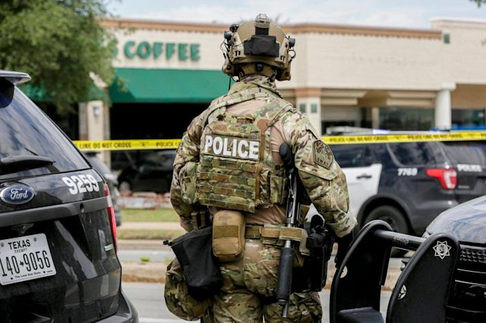 <p>There was a heavy police presence at the scene of Sunday's shooting</p> (Austin American-Statesman)
