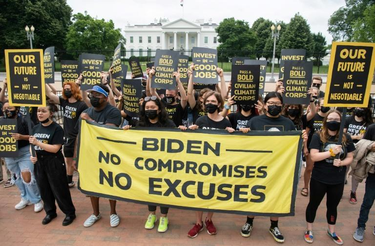 Protesters with the Sunrise Movement rallied in front of the White House against what they say is slow action on infrastructure legislation, job creation and addressing climate change