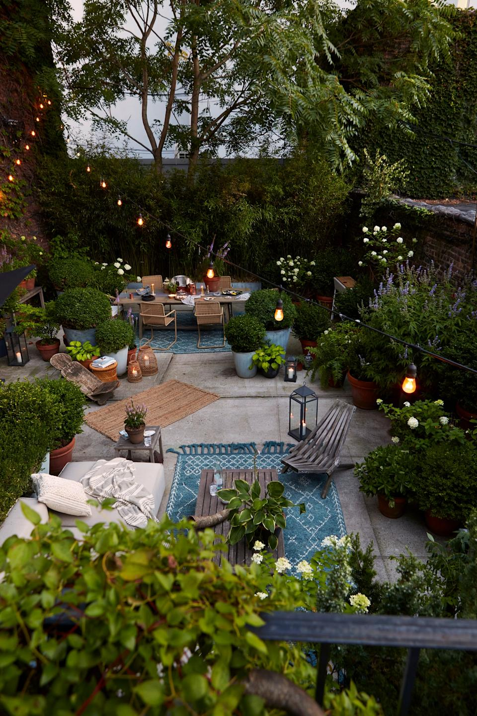 """<div class=""""caption""""> Mel's backyard is primarily composed of concrete and surrounded by brick, but she wanted the space to be lush. So her main objective was to use variations of greenery and textures to play off the hard textures. </div> <cite class=""""credit"""">Photography: Dane Tashima</cite>"""