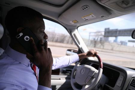 Liberian immigration activist Erasmus Williams drives to a meeting at the State Capitol the day after the Deferred Enforced Departure (DED) status was extended for a year by the Trump administration, in Minneapolis, Minnesota, U.S., March 29, 2019. REUTERS/Jonathan Ernst