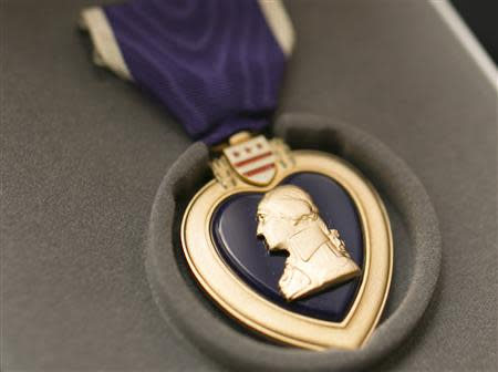 "World War II veteran Richard ""Dick"" Faulkner's Purple Heart medal is shown after it was presented to him in Auburn, New York March 8, 2014. REUTERS/Mike Bradley"