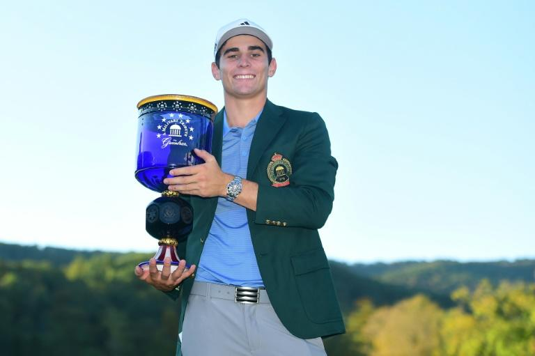 Joaquin Niemann roared home with three straight birdies on his final three holes, capping it off with a 25-foot bomb on 18, to become the youngest non-American winner on the Tour since 1923 (AFP Photo/Jared C. Tilton)