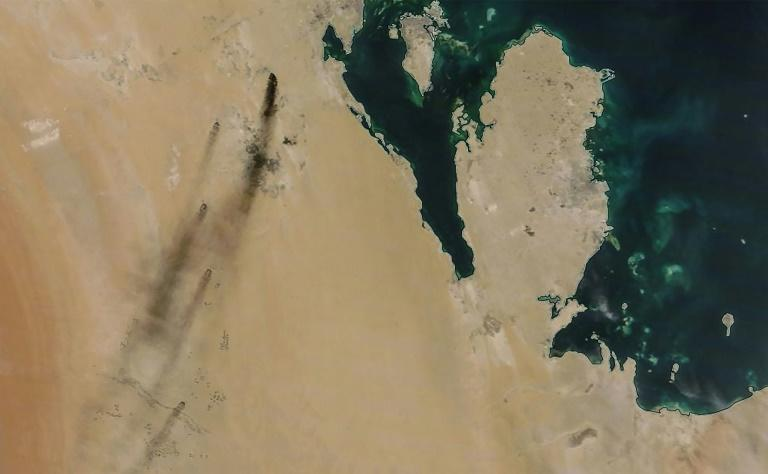 A satellite image provided by NASA Worldview shows fires following drone strikes on two major oil installation owned by the state giant Aramco, in eastern Saudi Arabia