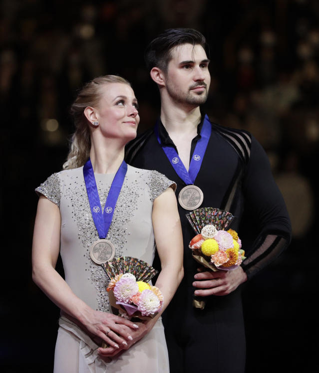 Madison Hubbell and Zachary Donohue of the U.S. stand after winning the bronze medals for the ice dance free dance during the ISU World Figure Skating Championships at Saitama Super Arena in Saitama, north of Tokyo, Saturday, March 23, 2019. (AP Photo/Andy Wong)