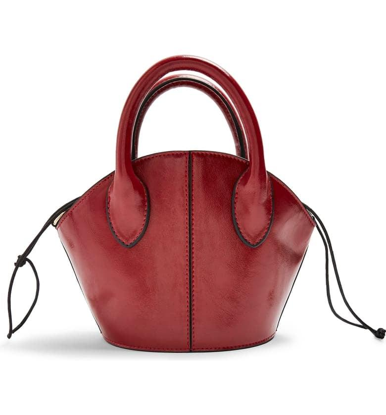 """<p>Grab this adorable little <a href=""""https://www.popsugar.com/buy/Topshop-Ted-Mini-Tote-483878?p_name=Topshop%20Ted%20Mini%20Tote&retailer=shop.nordstrom.com&pid=483878&price=48&evar1=fab%3Aus&evar9=45692490&evar98=https%3A%2F%2Fwww.popsugar.com%2Fphoto-gallery%2F45692490%2Fimage%2F46536290%2FTopshop-Ted-Mini-Tote&list1=shopping%2Caccessories%2Cbags&prop13=api&pdata=1"""" rel=""""nofollow"""" data-shoppable-link=""""1"""" target=""""_blank"""" class=""""ga-track"""" data-ga-category=""""Related"""" data-ga-label=""""https://shop.nordstrom.com/s/topshop-ted-mini-tote/5420701?origin=category-personalizedsort&amp;breadcrumb=Home%2FWomen%2FHandbags&amp;color=red"""" data-ga-action=""""In-Line Links"""">Topshop Ted Mini Tote</a> ($48) for all your weekend adventures.</p>"""