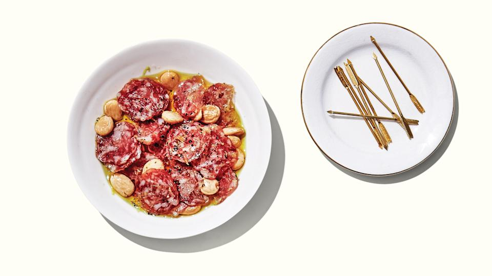 """Bright citrus and fresh-ground pepper put a festive spin on two party staples: Cured meat and Marcona almonds. <a href=""""https://www.bonappetit.com/recipe/lemon-pepper-salami-bites?mbid=synd_yahoo_rss"""" rel=""""nofollow noopener"""" target=""""_blank"""" data-ylk=""""slk:See recipe."""" class=""""link rapid-noclick-resp"""">See recipe.</a>"""