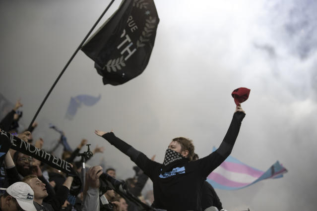 In this Sept. 29, 2019, photo, Minnesota United fans celebrate a second-half goal by Minnesota United defender Michael Boxall against Los Angeles FC at Allianz Field in St. Paul, Minn. The first season for Minnesota United at Allianz Field has been a sold-out success. As the Loons prepare for their first MLS playoff game, they'll have their raucous supporters section behind them to help. (Jerry Holt/Star Tribune via AP)
