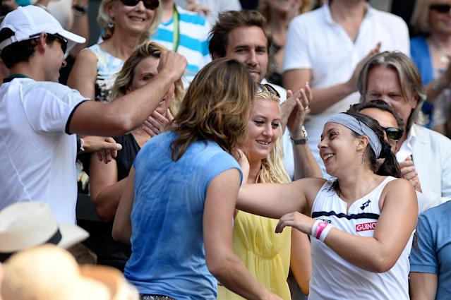 LONDON, ENGLAND - JULY 06: Marion Bartoli of France celebrates victory with family, friends and members of her coaching team after the Ladies' Singles final match against Sabine Lisicki of Germany on day twelve of the Wimbledon Lawn Tennis Championships at the All England Lawn Tennis and Croquet Club on July 6, 2013 in London, England. (Photo by Dennis Grombkowski/Getty Images)
