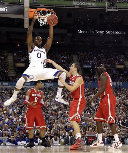 Kansas forward Thomas Robinson (0) slam dunks over Ohio State guard Aaron Craft (4) during the second half of an NCAA Final Four semifinal college basketball tournament game Saturday, March 31, 2012, in New Orleans. (AP Photo/David J. Phillip)