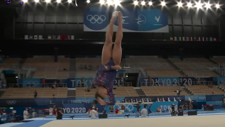 Gymnast Jordan Chiles backflipping through the air at the 2021 Olympics in Japan.