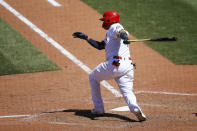 St. Louis Cardinals' Yadier Molina follows through on the game winning RBI single during the ninth inning of a baseball game against the Miami Marlins Wednesday, June 16, 2021, in St. Louis. (AP Photo/Scott Kane)