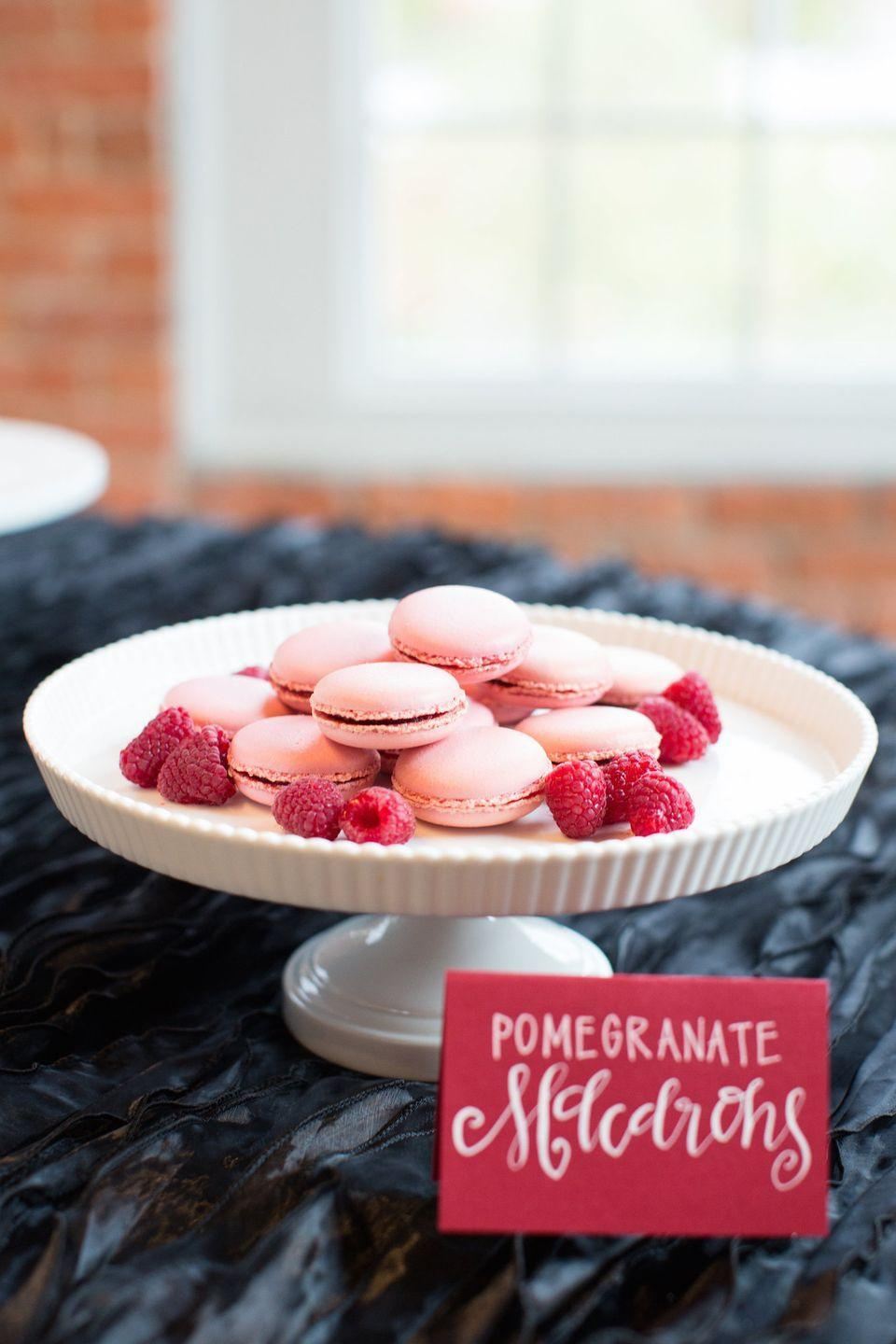 "<p>One of the loveliest aspects of Valentine's Day (besides celebrating the love in your life, of course) is that the holiday's colors make it easy for food to double as themed decor. Here, raspberries sprinkled around pink pomegranate macarons make for a treat that's appealing to the eyes and the tastebuds. </p><p><em>Via <a href=""http://sugareuphoria.com/"" rel=""nofollow noopener"" target=""_blank"" data-ylk=""slk:Sugar Euphoria"" class=""link rapid-noclick-resp"">Sugar Euphoria</a></em></p><p><a class=""link rapid-noclick-resp"" href=""https://www.danasbakery.com/products/its-a-girl-1?variant=34420522122¤cy=USD&gclid=CjwKCAiA9vOABhBfEiwATCi7GJxeu2izOe5qzdPxddJNIejnVAglD2gP8jaHCstUJYfMNW6Su3_BpRoC8ZcQAvD_BwE"" rel=""nofollow noopener"" target=""_blank"" data-ylk=""slk:GET THE LOOK"">GET THE LOOK</a><br><em>Chocolate-Covered Strawberry Box, Dana's Bakery, $36</em><br></p>"