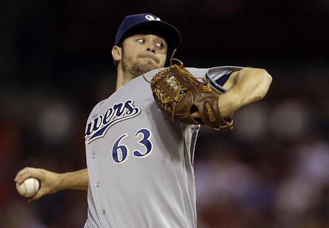 Milwaukee Brewers starting pitcher Tyler Thornburg throws during the first inning of a baseball game against the St. Louis Cardinals, Thursday, Sept. 12, 2013, in St. Louis. (AP Photo/Jeff Roberson)