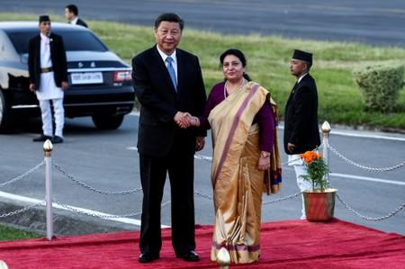 Nepal's President Bidhya Devi Bhandari shakes hands with China's President Xi Jinping during a welcome ceremony at the Tribhuvan International Airport in Kathmandu