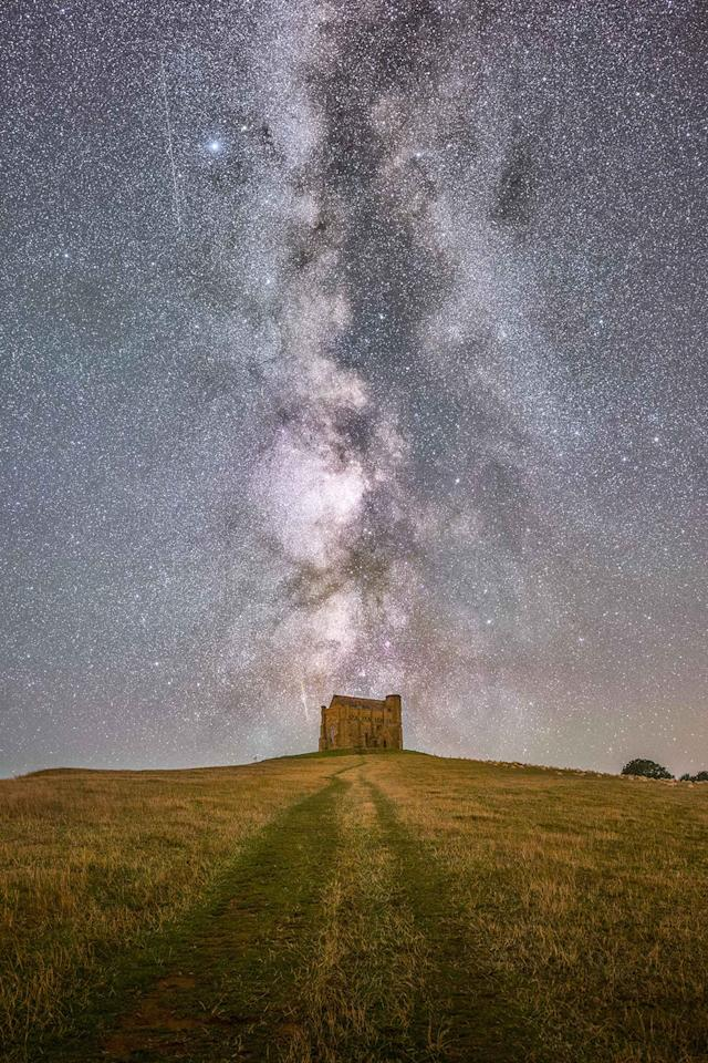 <p>The path to St. Catherine's Chapel above Abbotsbury in West Dorset almost feels like the pathway to heaven with the Milky Way seen above it. (Photo: Stephen Banks/Caters News) </p>