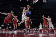 China's Meng Li (9) drives to the basket against Belgium during a women's basketball game at the 2020 Summer Olympics, Monday, Aug. 2, 2021, in Saitama, Japan. (AP Photo/Eric Gay)
