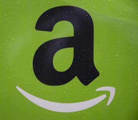 The Amazon.com, Inc. logo is seen on the side of a delivery truck in Brooklyn, New Yor