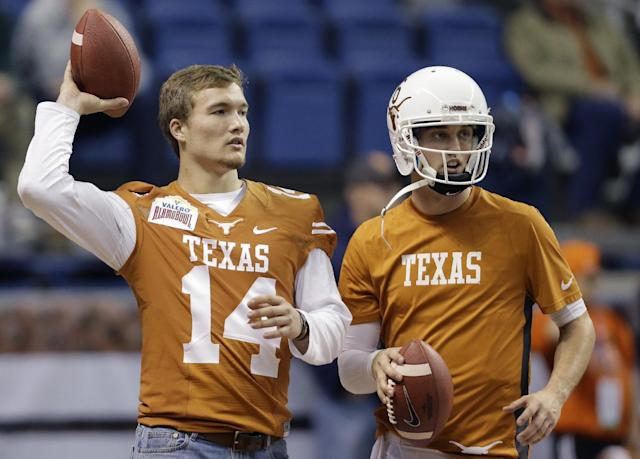 Texas Longhorns's David Ash, left, and Case McCoy, right, throw before the Valero Alamo Bowl NCAA college football game against Oregon, Monday, Dec. 30, 2013, in San Antonio. Case will start in the place of Ash who in injured. (AP Photo/Eric Gay)