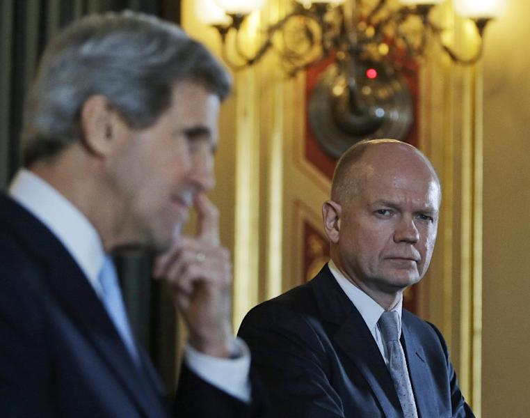 Britain's Foreign Secretary William Hague, right, watches as US Secretary of State John Kerry, left, answers a reporter's question during a joint news conference following their meeting in central London, Monday, Feb. 25, 2013. This is the first overseas trip for the US Secretary of State in his new role. (AP Photo/Lefteris Pitarakis, pool)