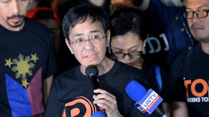 Maria Ressa (C), the CEO and editor of online portal Rappler, speaks during a protest on press freedom