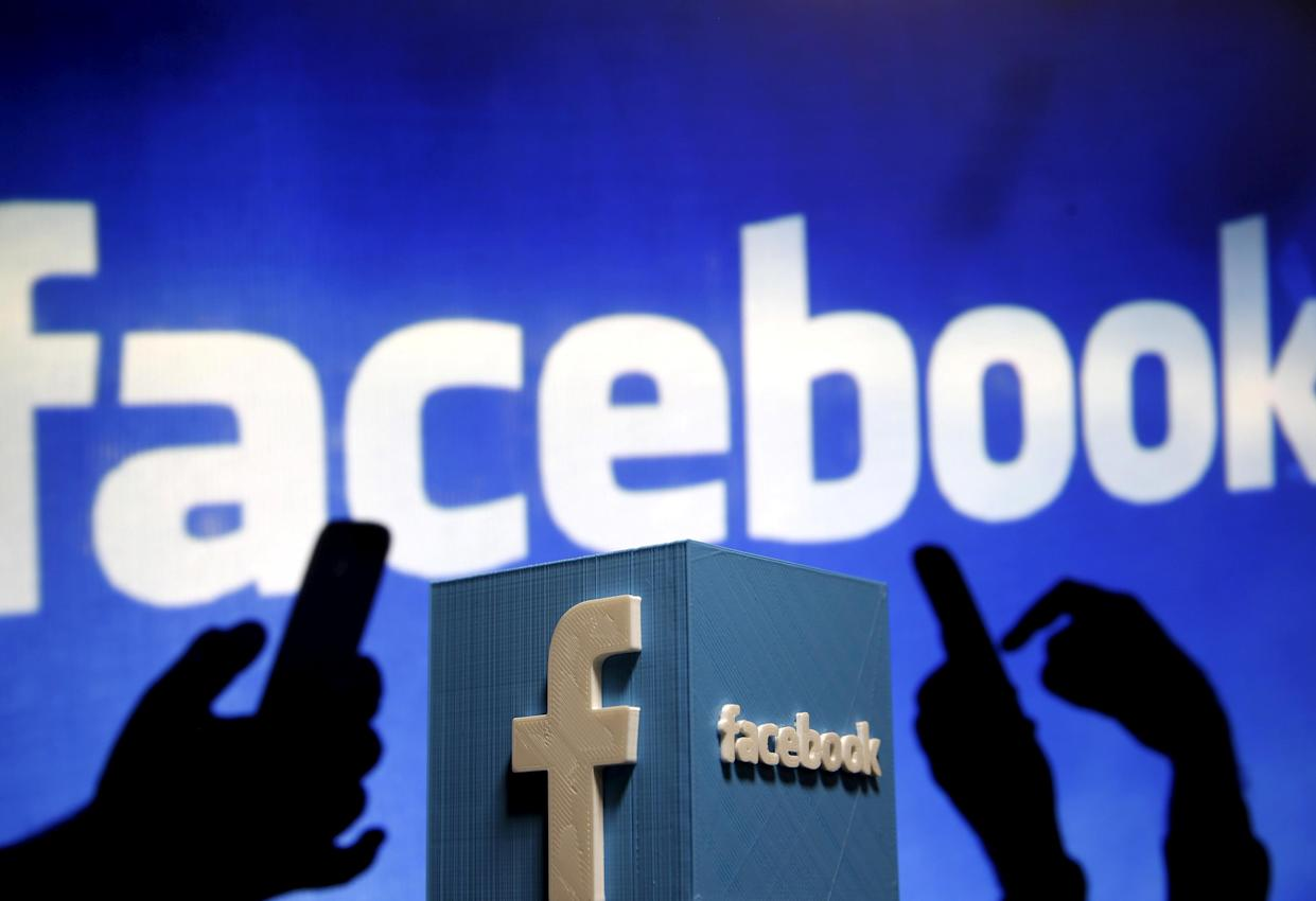 """Facebook is under fire for its refusal to make public numerous political ads generated by a Russian """"troll factory."""" (Photo: Dado Ruvic; Illustration: Reuters)"""