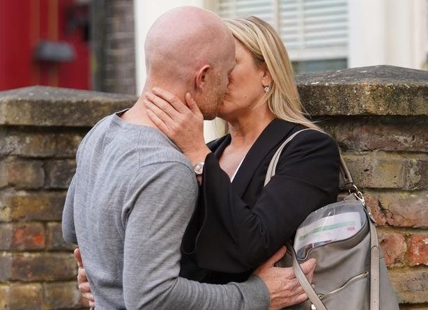 Max Branning and Mel Owen share a kiss in 'EastEnders' filmed last year before the pandemic. (BBC)