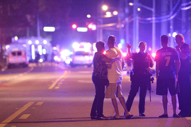 <p>Orlando Police officers direct family members away from a fatal shooting at Pulse Orlando nightclub in Orlando, Fla., Sunday, June 12, 2016. (AP Photo/Phelan M. Ebenhack) </p>