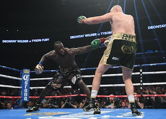 Deontay Wilder and Tyson Fury face a likely rematch in 2019 after their thrilling heavyweight battle (AFP Photo/Harry How)