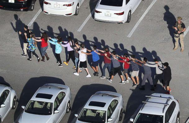 PHOTO: Students are brought out of the Marjory Stoneman Douglas High School after a shooting at the school that reportedly killed and injured multiple people on Feb. 14, 2018, in Parkland, Fla. (Joe Raedle/Getty Images, FILE)