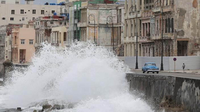 Storm Laura has already brought rough seas and high winds in the Caribbean