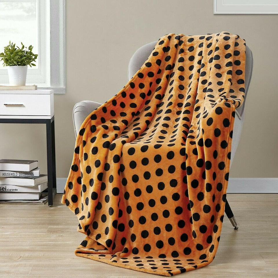 <p>The <span>Polka Dot Spooky Ultra Soft Blanket</span> ($29) will add the perfect amount of spook to your home. </p>