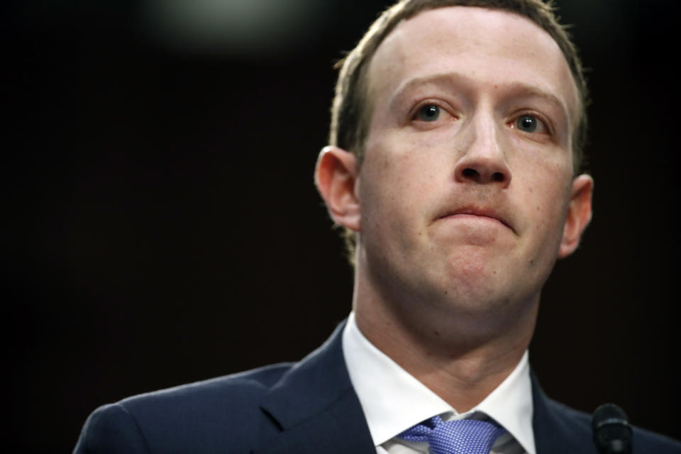 Facebook CEO Mark Zuckerberg pauses while speaking as he testifies before a joint hearing of the Commerce and Judiciary Committees on Capitol Hill in Washington, Tuesday, April 10, 2018, about the use of Facebook data to target American voters in the 2016 election. (AP Photo/Alex Brandon)