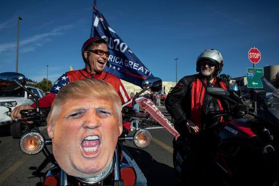 Supporters of President Donald Trump attend a rally and car parade Saturday, Aug, 29, 2020, from Clackamas to Portland, Oregon (AP)