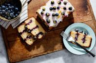 """Slice into this lemony cake and you'll be greeted with a surprise: bold stripes of bright blueberry filling. <a href=""""https://www.epicurious.com/recipes/food/views/lemon-blueberry-poke-cake?mbid=synd_yahoo_rss"""" rel=""""nofollow noopener"""" target=""""_blank"""" data-ylk=""""slk:See recipe."""" class=""""link rapid-noclick-resp"""">See recipe.</a>"""